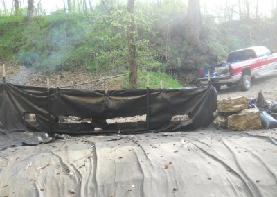 5-1-13 geotextile behind hog panel fence